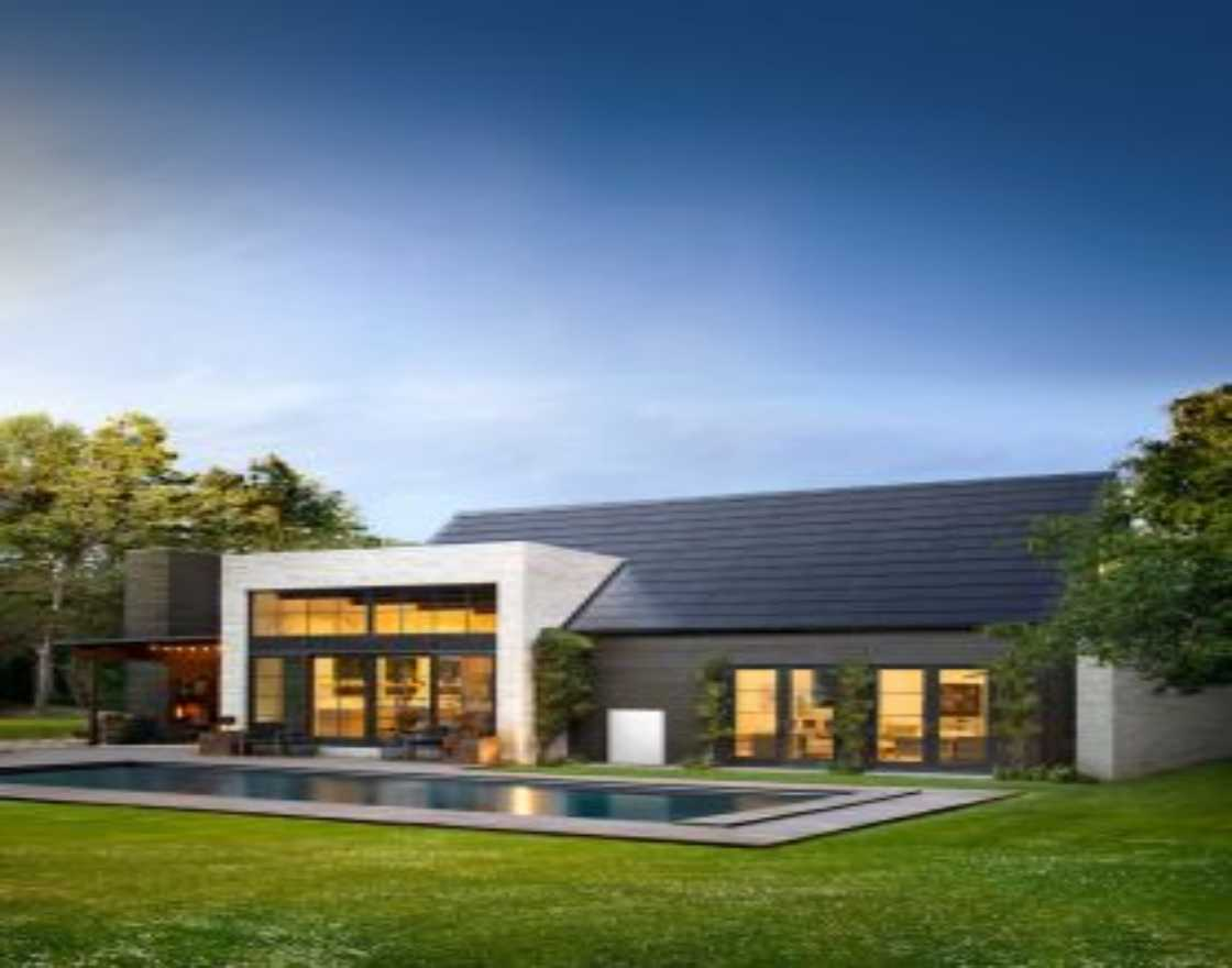 Tesla Solar Roof and Powerwall energy storage unit installed at a customer's house