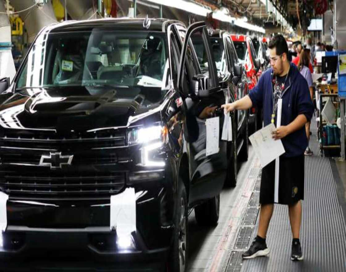 Trucks come off the assembly line at GM's Chevrolet Silverado and GMC Sierra pickup truck plant in Fort Wayne, Indiana