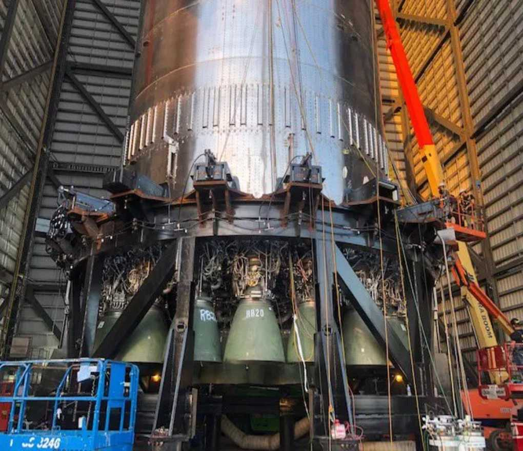 Elon Musk posted this photo of a SpaceX Super Heavy booster prototype, with its newly installed Raptor engines, on Twitter on Aug. 2, 2021.
