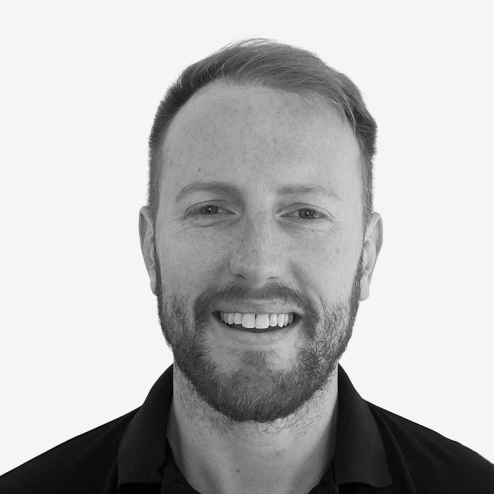 A headshot photograph of Speero's customer experience client Dan Layfield, the growth product manager at Code Academy.