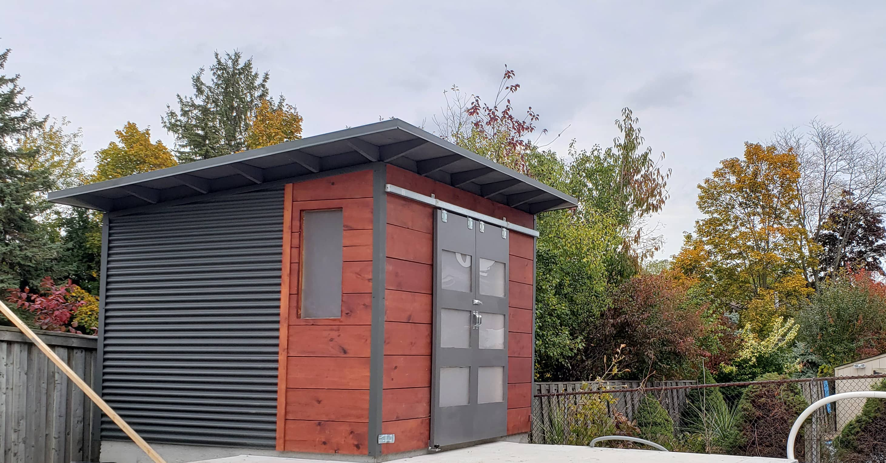 12' x 8' Custom Modern Shed with Mahogany Stain Shiplap and Charcoal Steel