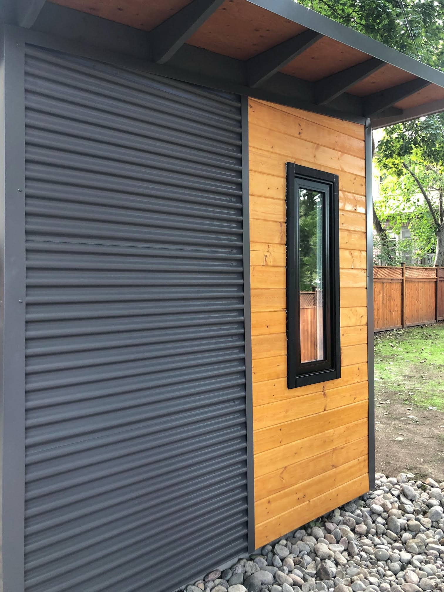 Custom Shed Side with Cedar Stained Pine and Charcoal Steel