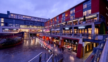 The Mailbox courtyard with retail outlets, restaurants and canal-side dining.