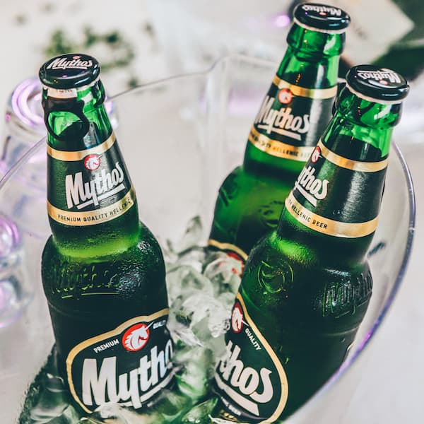 bottles of mythos chilled in a bucket with ice