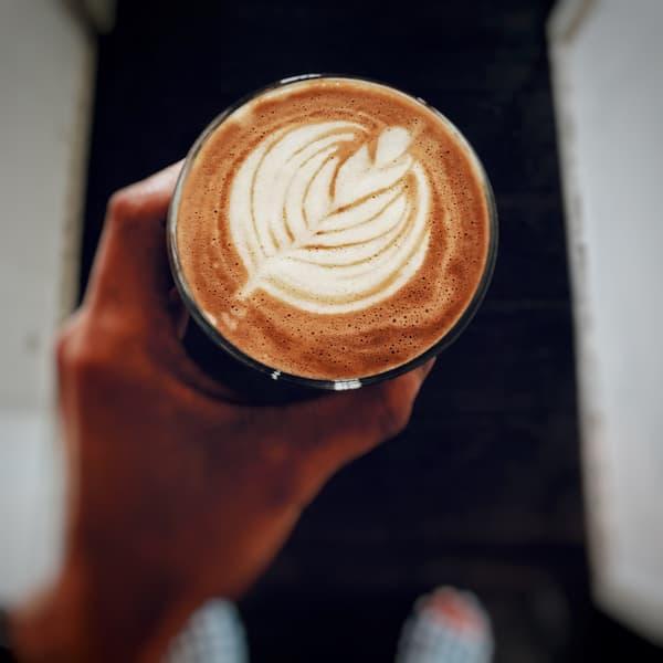 a tulilp drawn in latte art