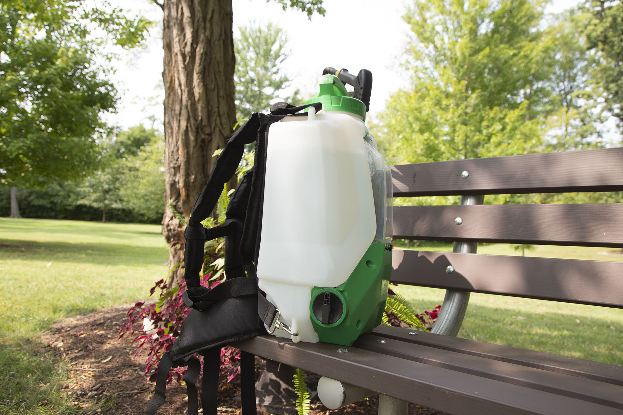 FlowZone Typhoon 2.5 backpack sprayer on a bench in a park