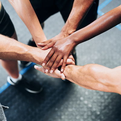community with hands together