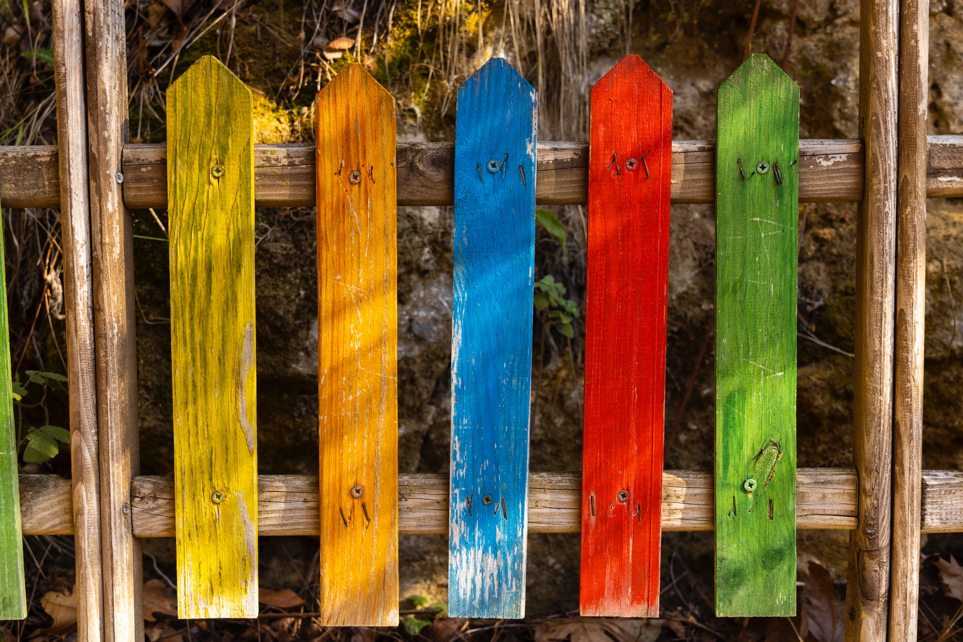 An image of a rainbow picket fence