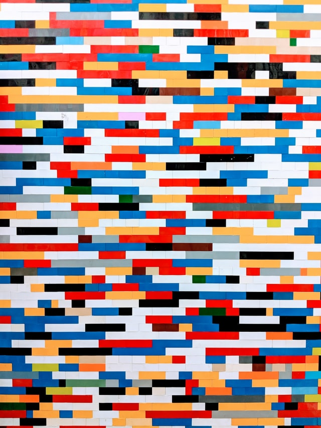 An image of a wall made of many differently colored legos