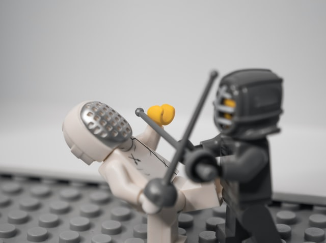 An image of two lego fencers sword fighting