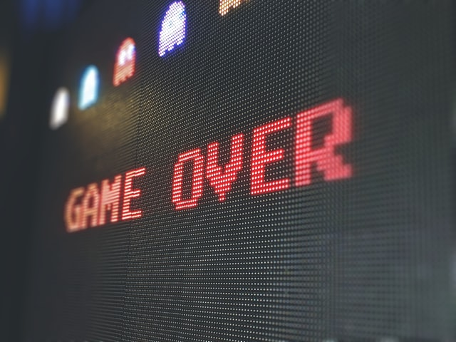 A close-up, shallow depth-of-field shot of the game over screen from Pac Man.