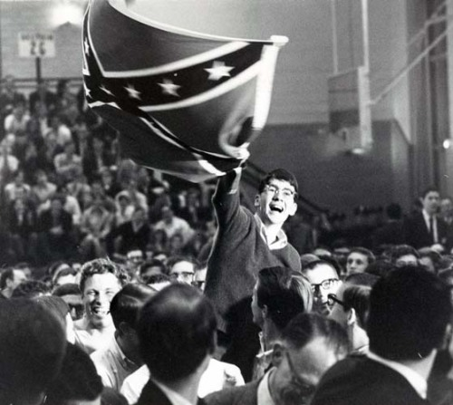 Student waving a Confederate flag at a 1967 event with George Wallace.