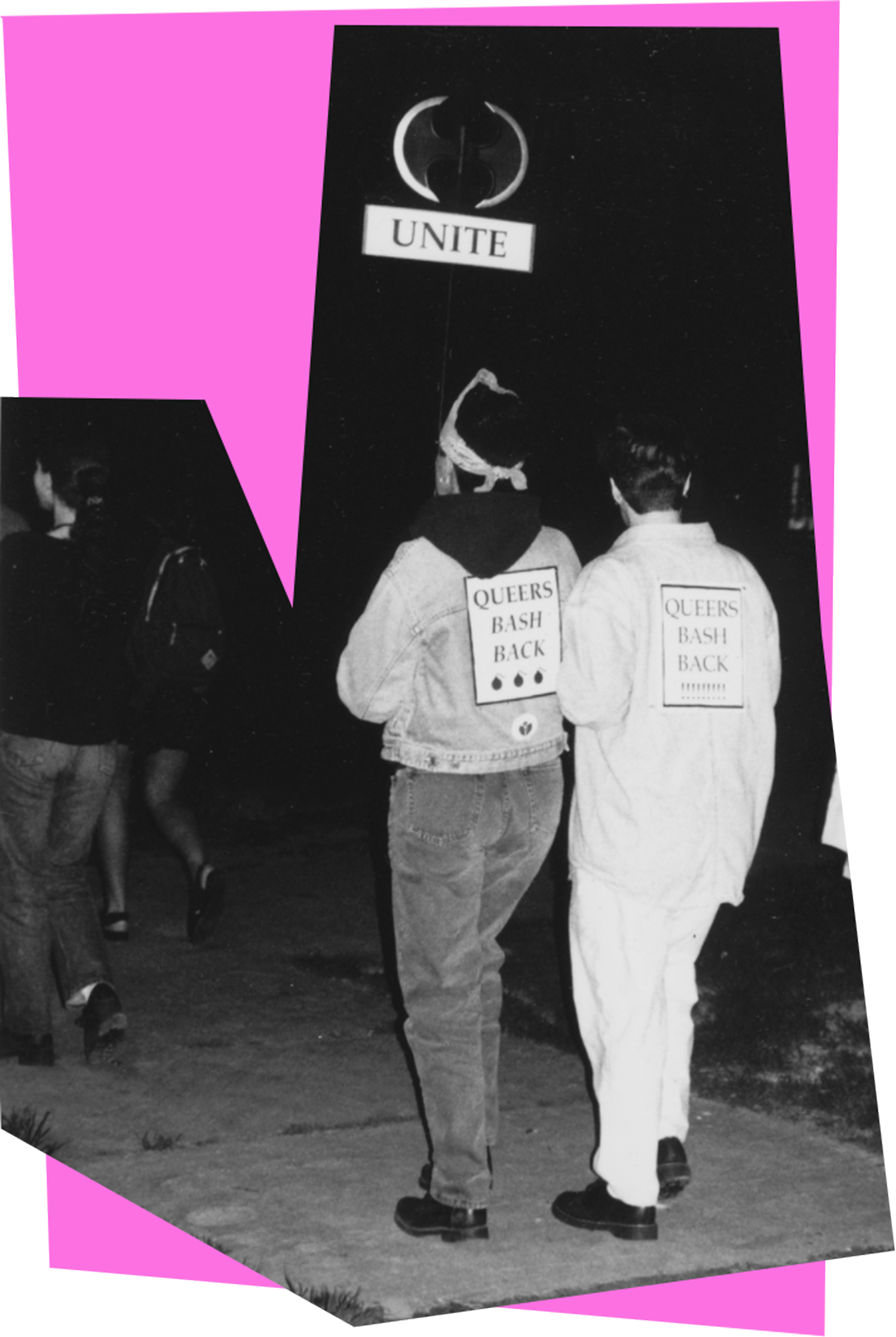 """Students marching in a Take Back the Night event, with the signs """"Queers Bash Back"""" attached to their backs."""