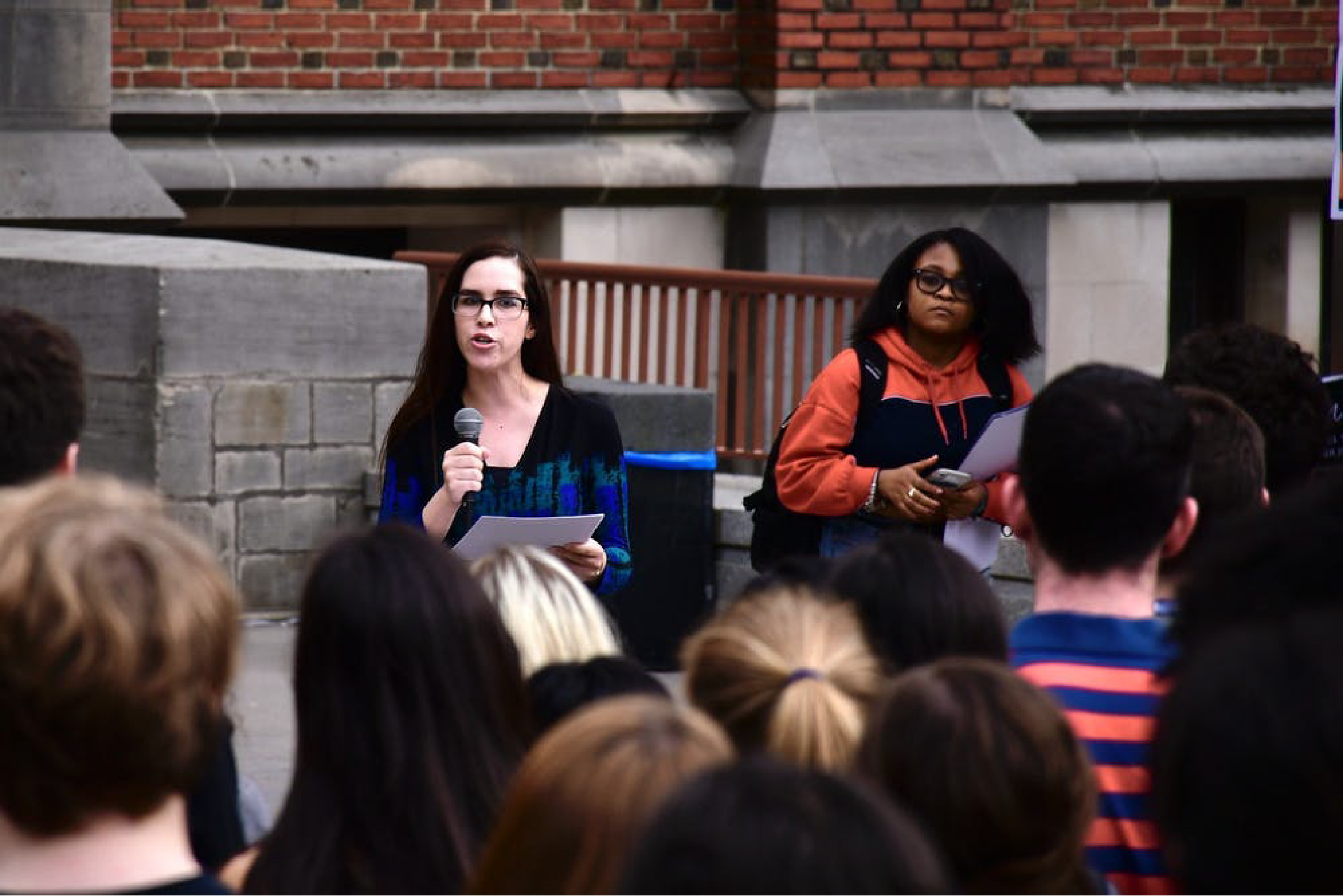 Students with microphones addressing a crowd outside of Frist Campus Center during a 2019 SPEAR event.