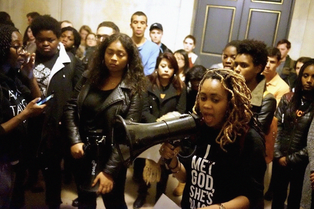 A member of the Black Justice League speaks to a group of students in Nassau Hall during the 2015 sit-in.