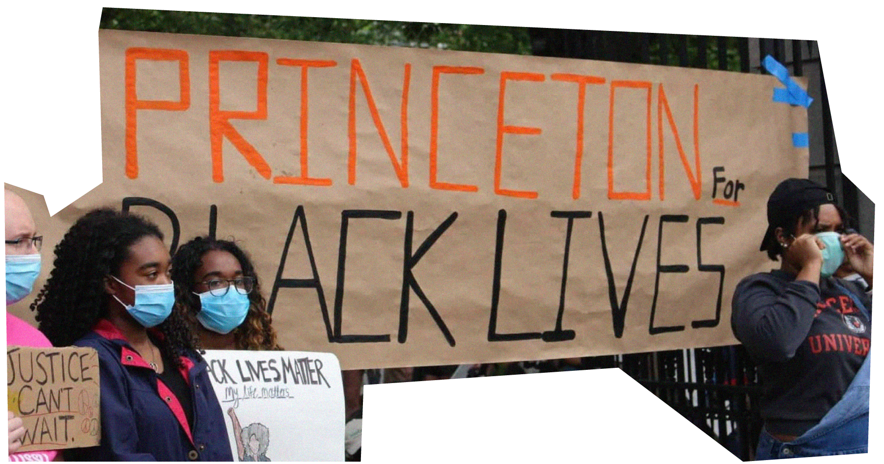 """Students protesting in front of a banner that reads """"Princeton for Black Lives"""" in 2020."""