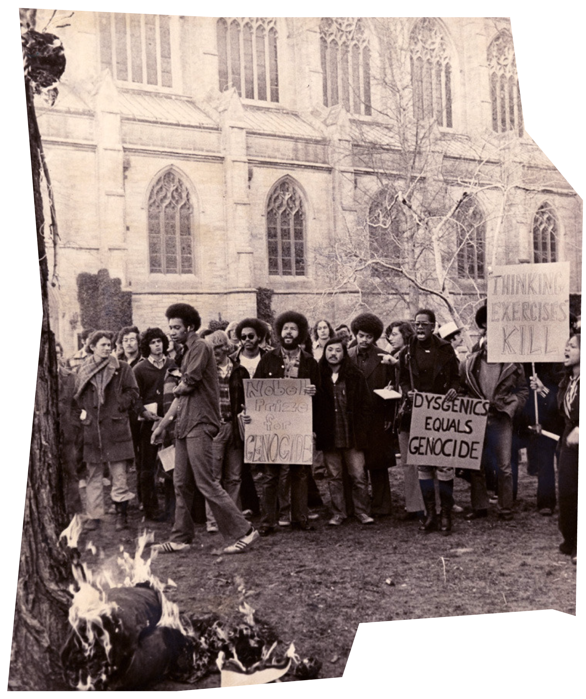 """Group of students protesting an event with William B. Shockley outside McCosh Hall in 1973, with signs including """"Nobel Prize for Genocide"""" and """"Dysgenics Equals Genocide."""""""