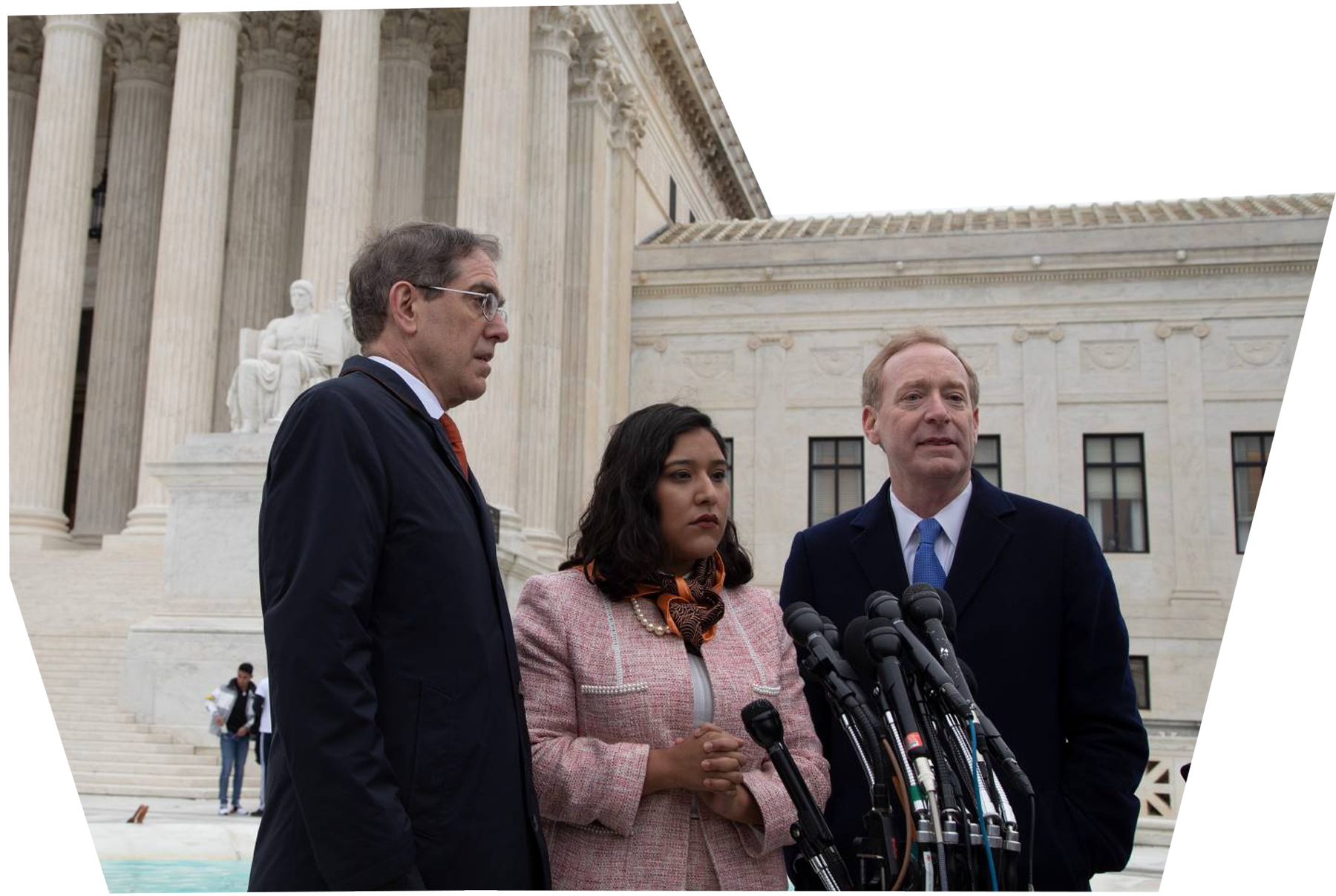Maria Perales Sanchez '18 standing with University President Christopher Eisgruber and University Trustee Brad Smith in front of the Supreme Court after a DACA case in 2019.