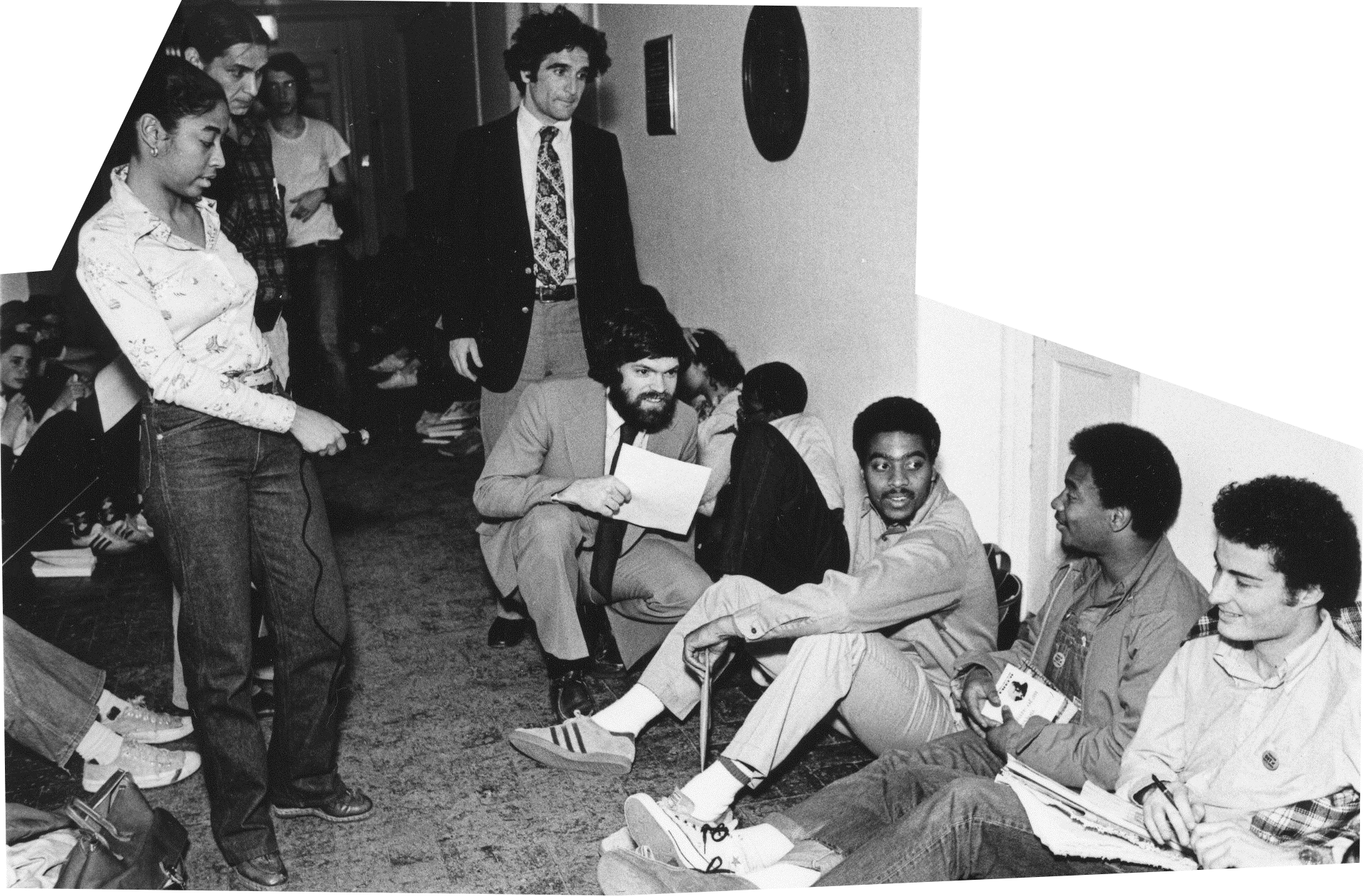 Students sitting inside Nassau Hall in 1978, with administrators gathered around.