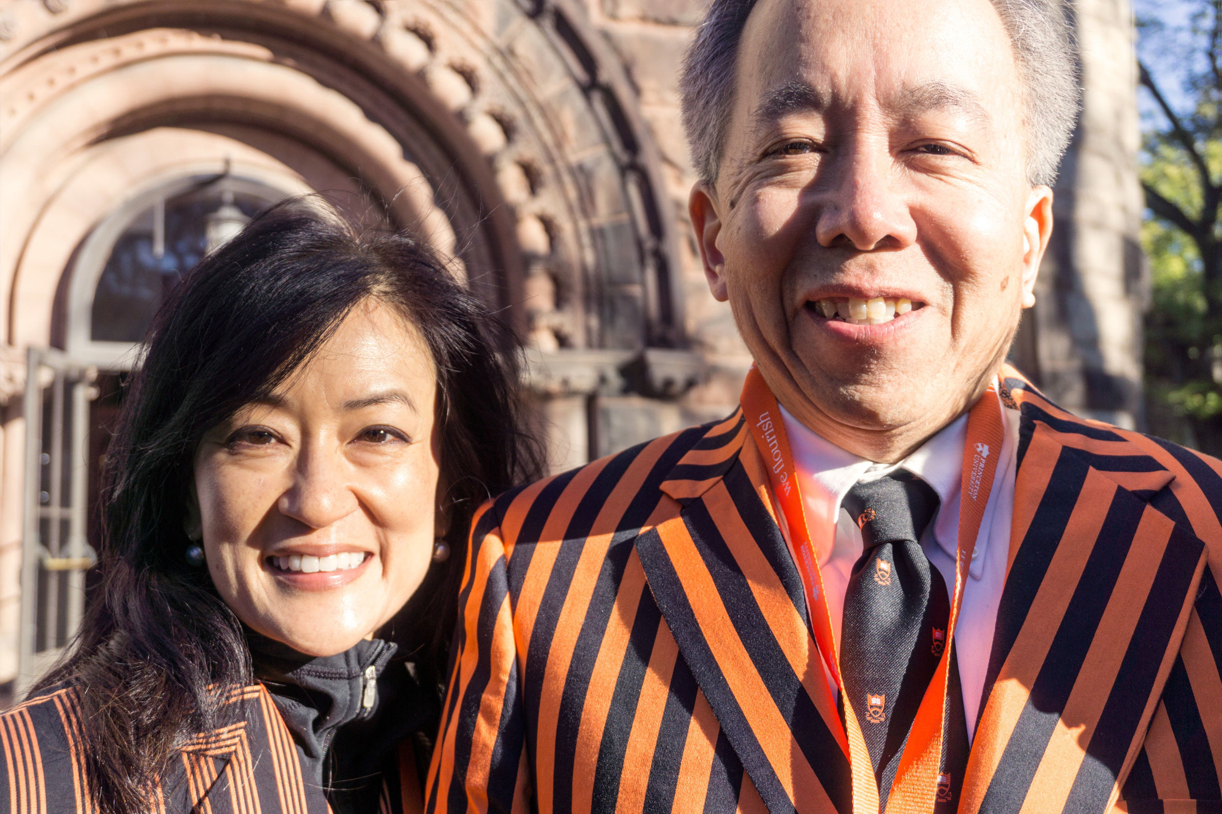 Alumni wearing Reunions jackets in front of Alexander Hall.