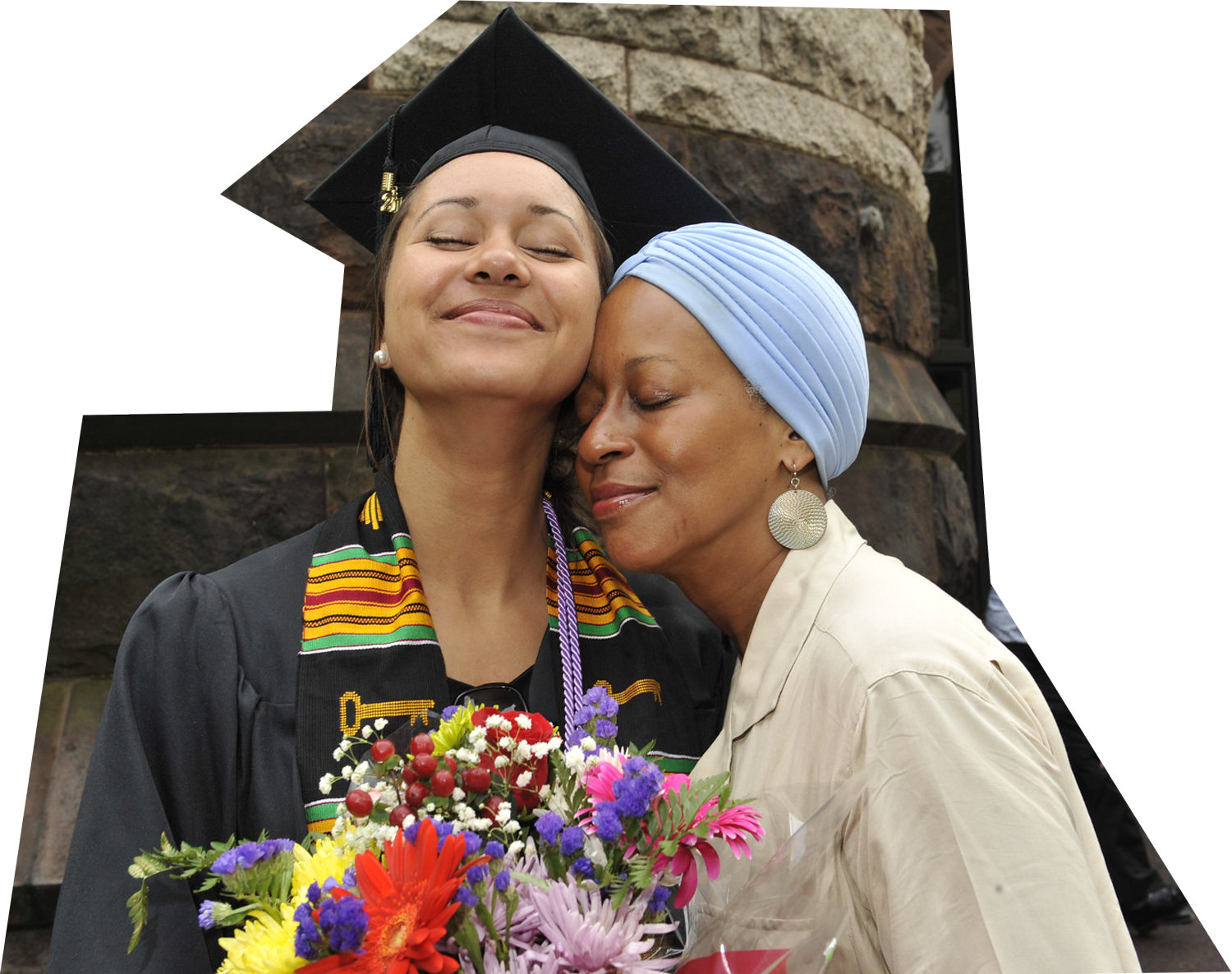 Emily McDonald '15 embracing her aunt Christiane Berry '81 outside of Alexander Hall during the 2015 Pan-African Graduation.
