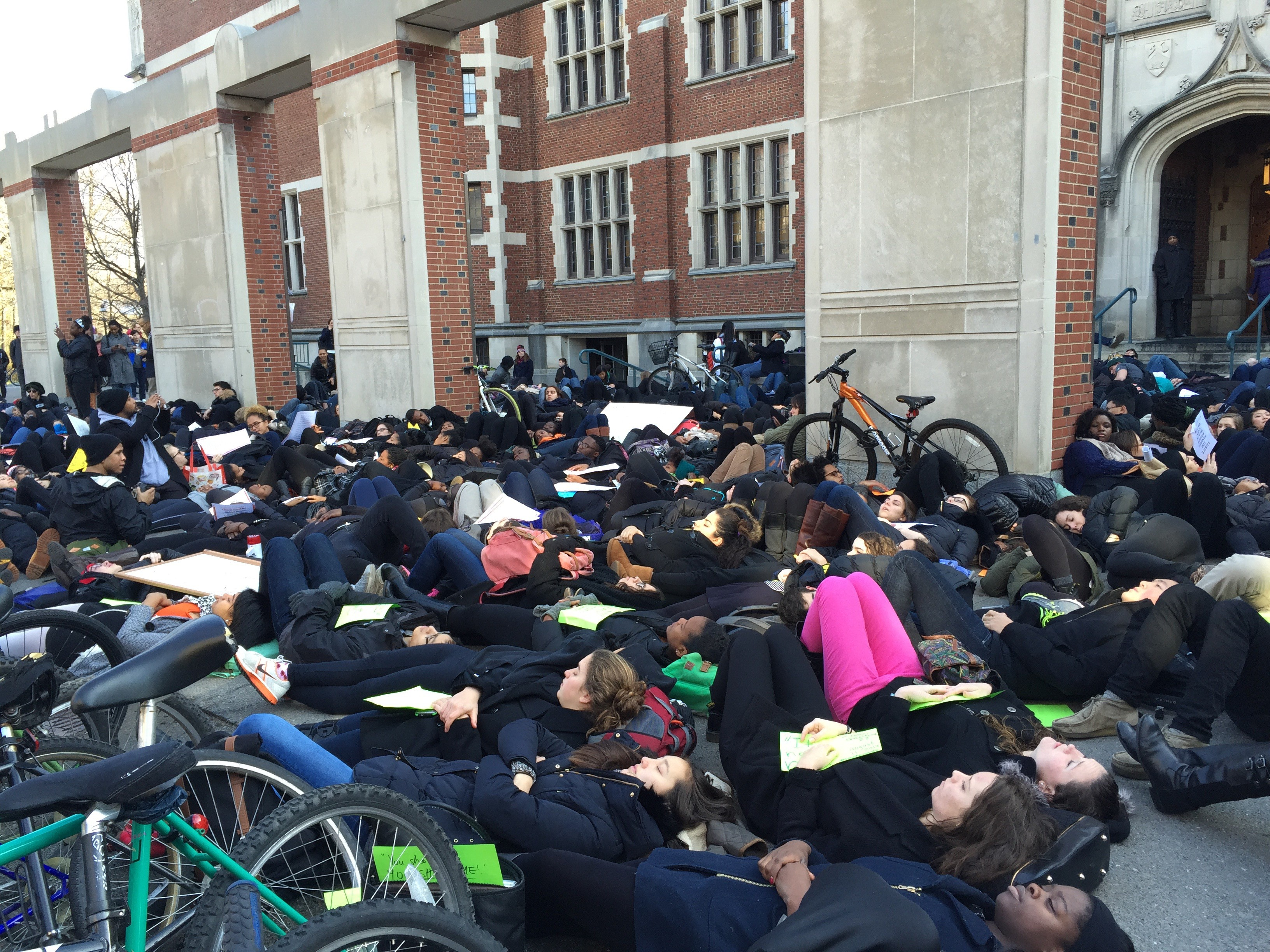 A large crowd of students lying on the ground outside of Frist Campus Center in 2014, protesting against police brutality.