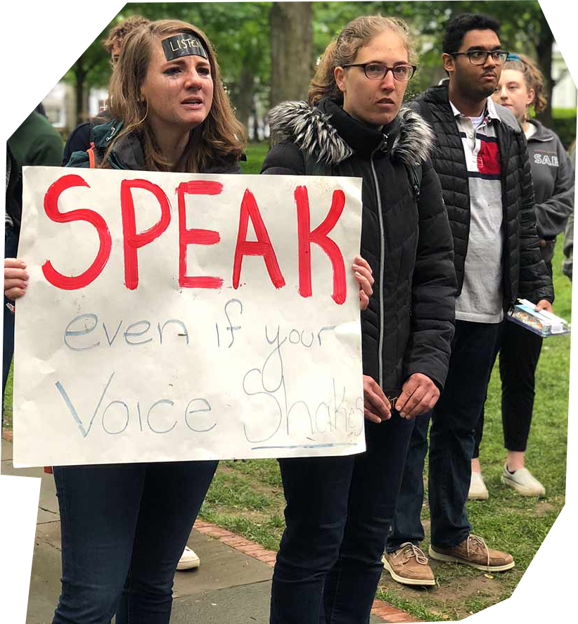 """Students overcome with emotion while protesting against Princeton's Title IX policies, with a sign """"Speak Even If Your Voice Shakes."""""""