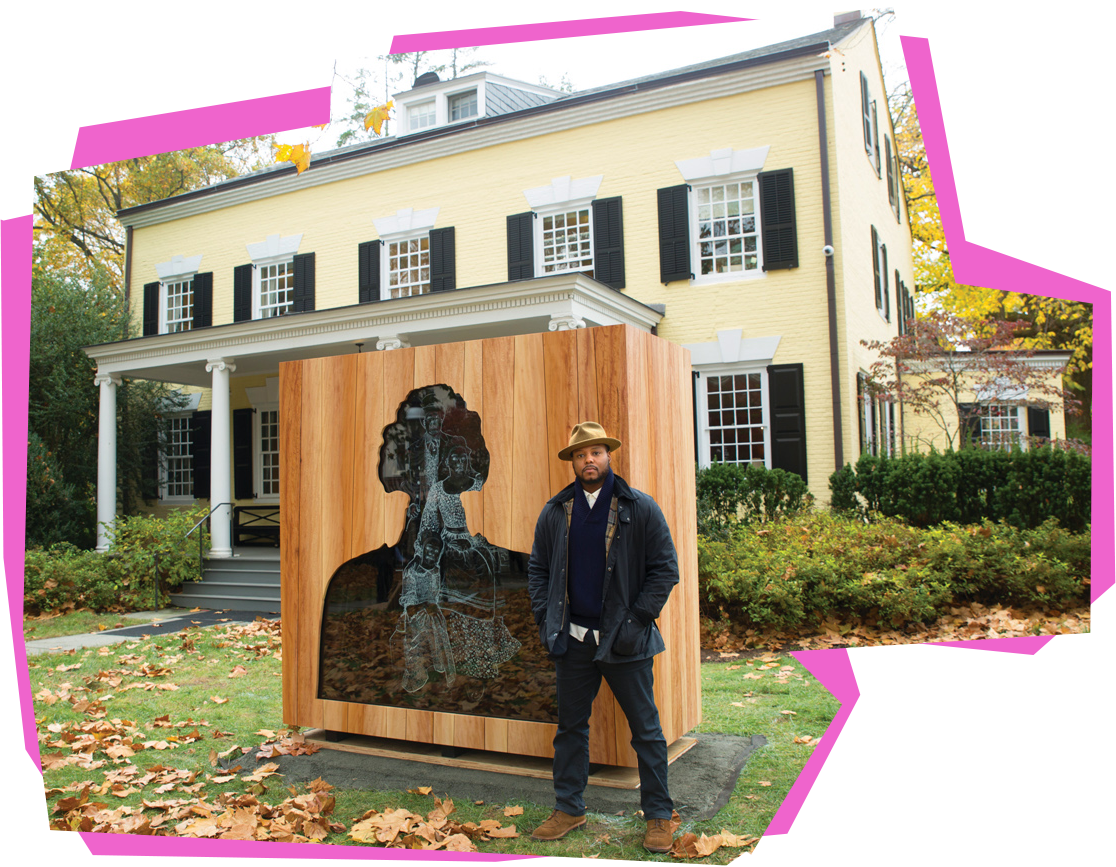 """Artist Titus Kaphar with """"Impressions of Liberty,"""" his art installation of Princeton's fifth president Samuel Finley and a family of slaves in the 1700s, in front of Maclean House."""
