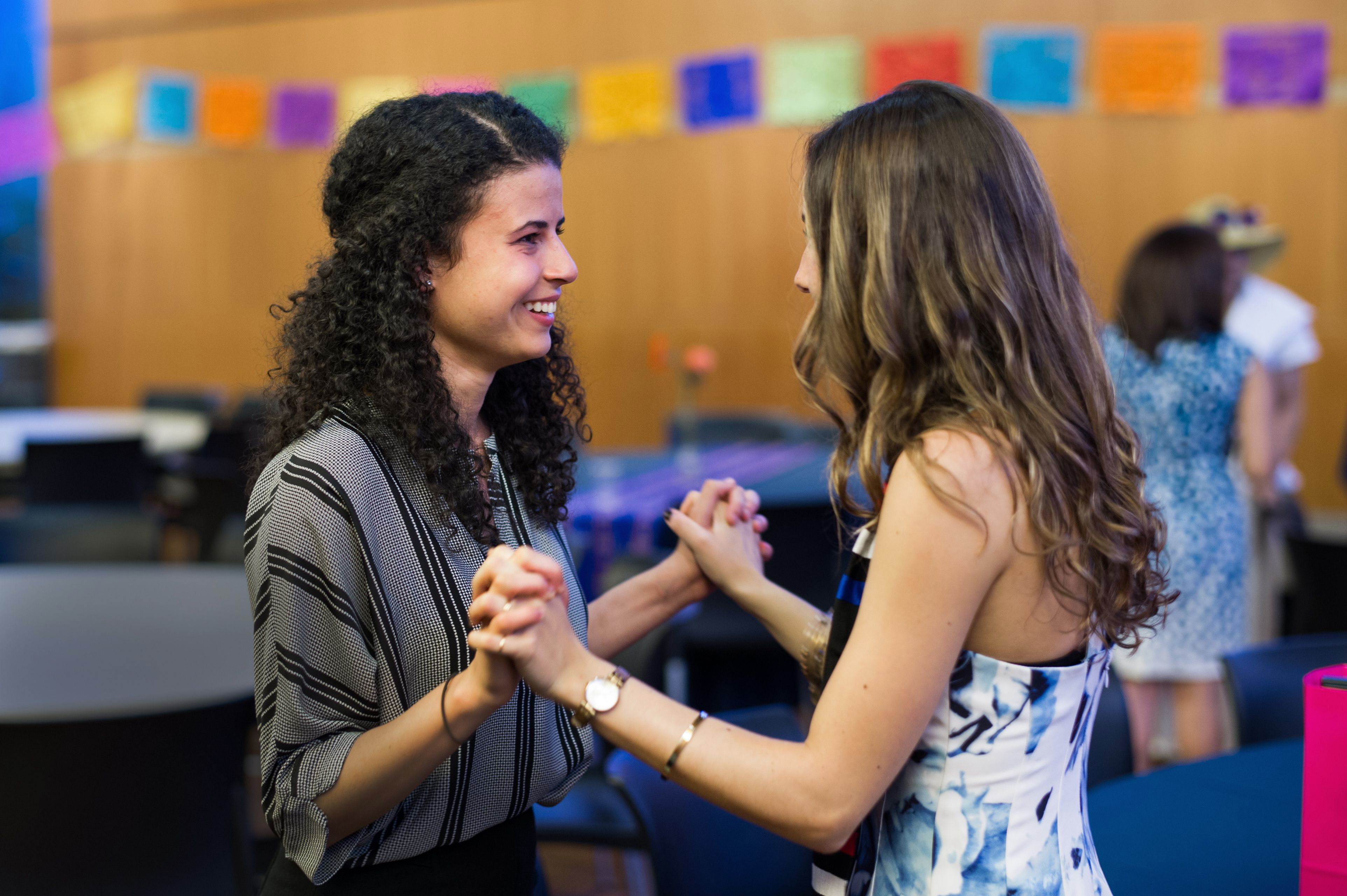 Students holding hands at the Latinx Graduation in 2016.