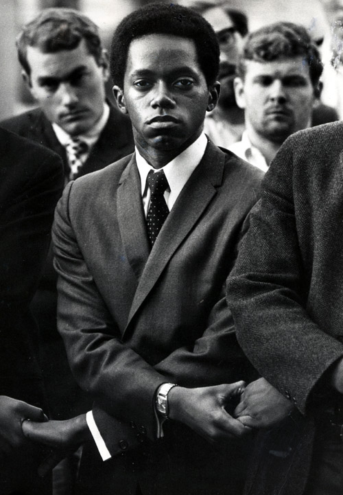 Marion Sleet '69 holding hands with other students during a campus vigil for Martin Luther King, Jr. in 1968.