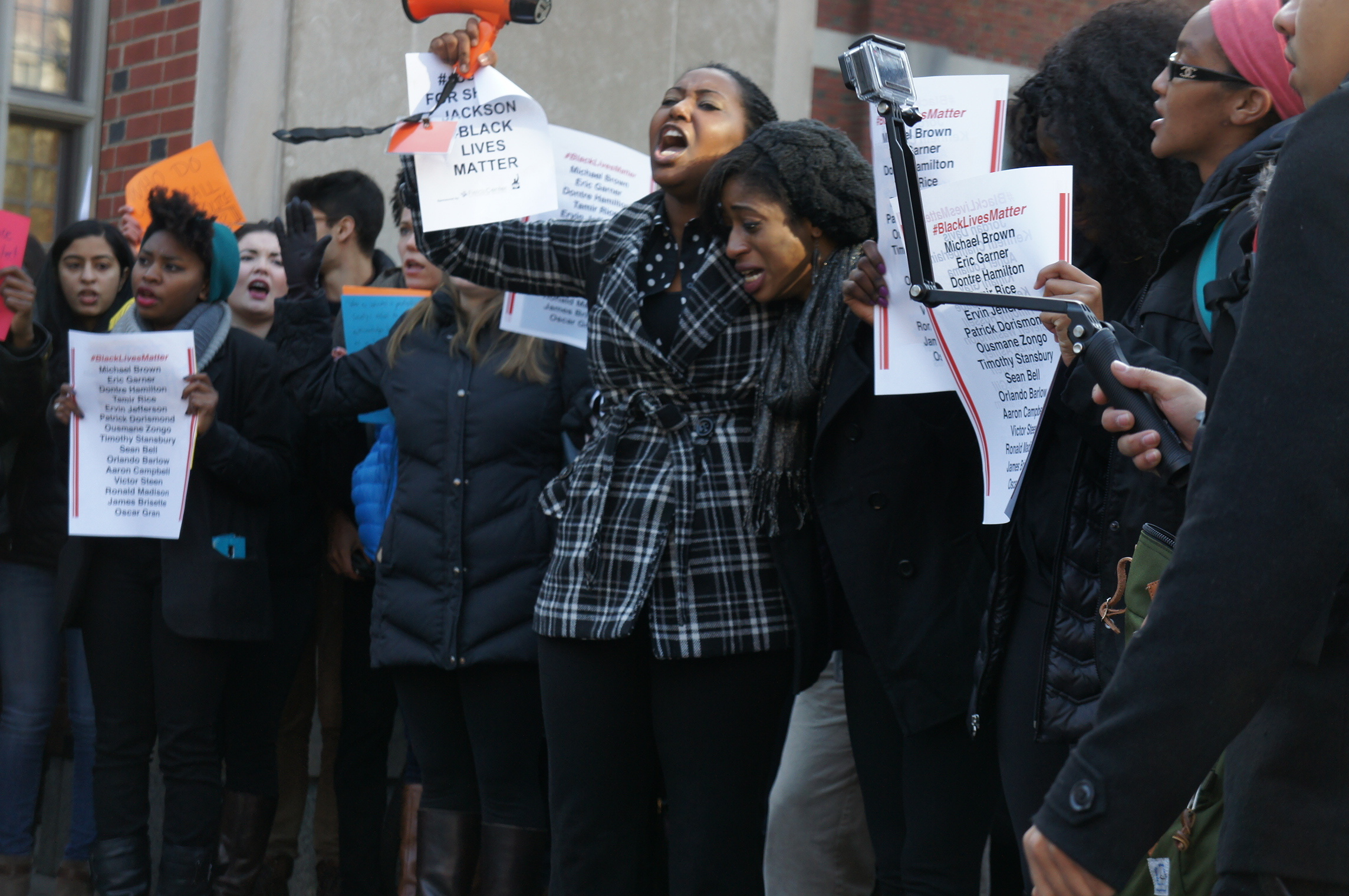 Students displaying outrage and grief in a protest against police brutality outside of Frist Campus Center in 2014.