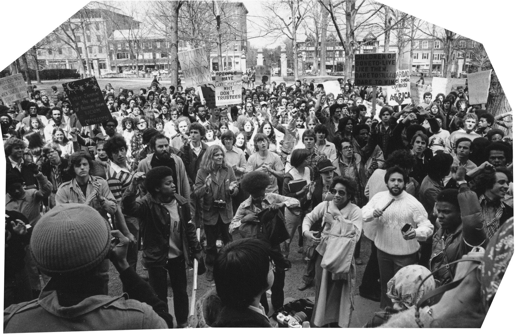 """Hundreds of students outside of Nassau Hall protesting against South African apartheid in 1978, with signs like """"People Have Consciences, Why Don't Trustees."""""""