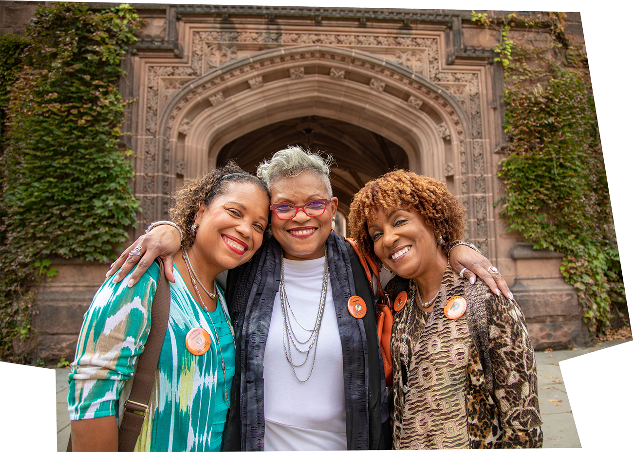 Ivy Thomas McKinney '77, Evora Thomas '74 and Daphne Thomas Jones '77 standing in front of East Pyne Hall during an alumni conference in 2018.
