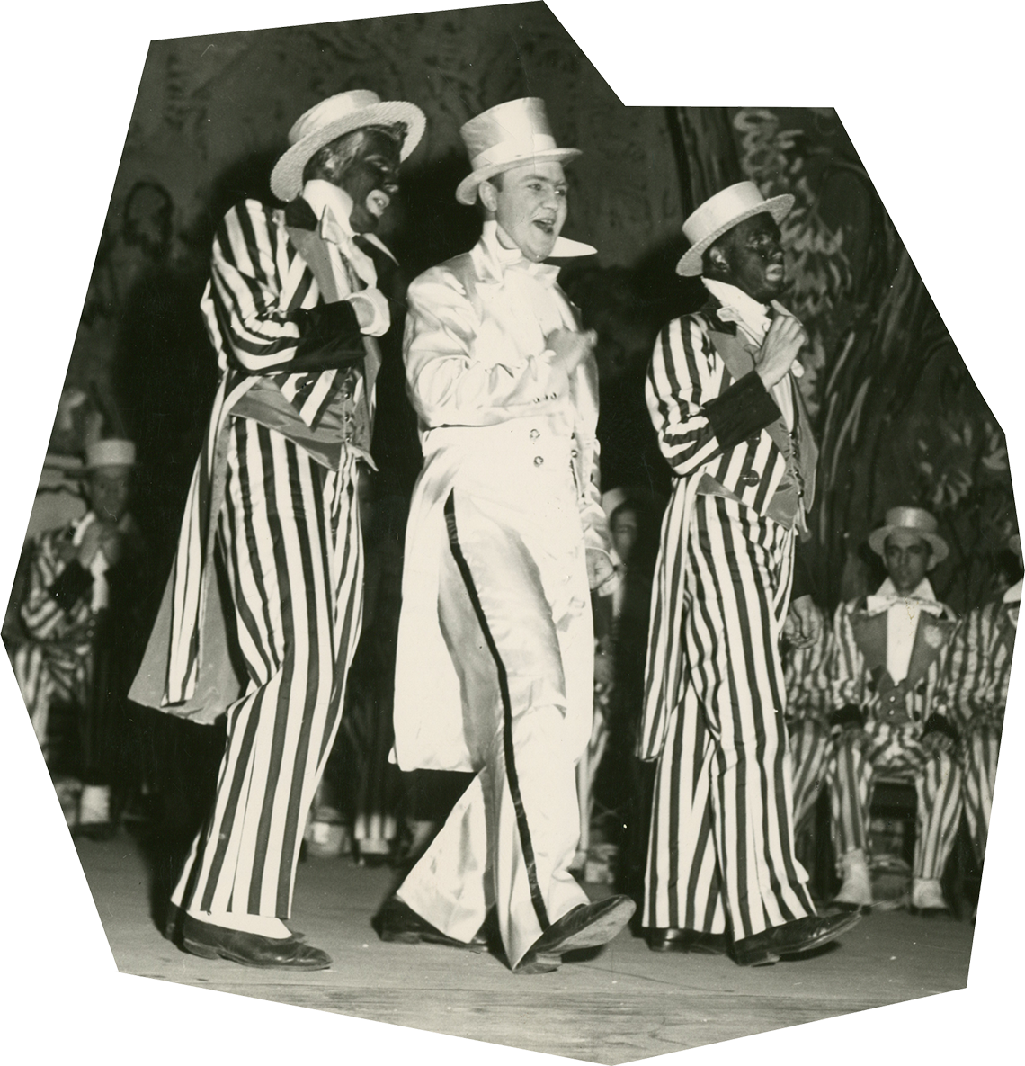 """Students wearing costumes and blackface during a 1949 Triangle Club performance of the show """"All in Favor."""""""