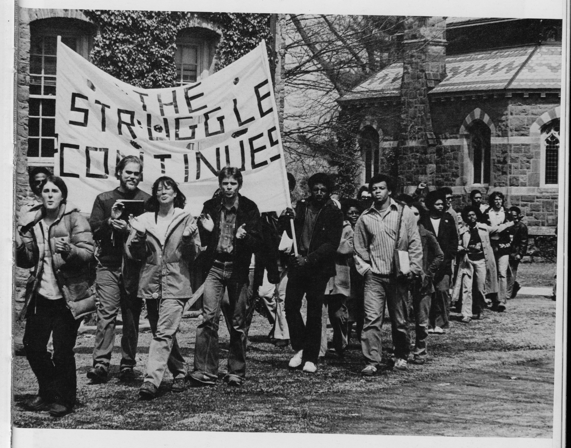 """Image of Princeton Students protesting in the 70s holding a banner saying """"The Struggle continues"""""""