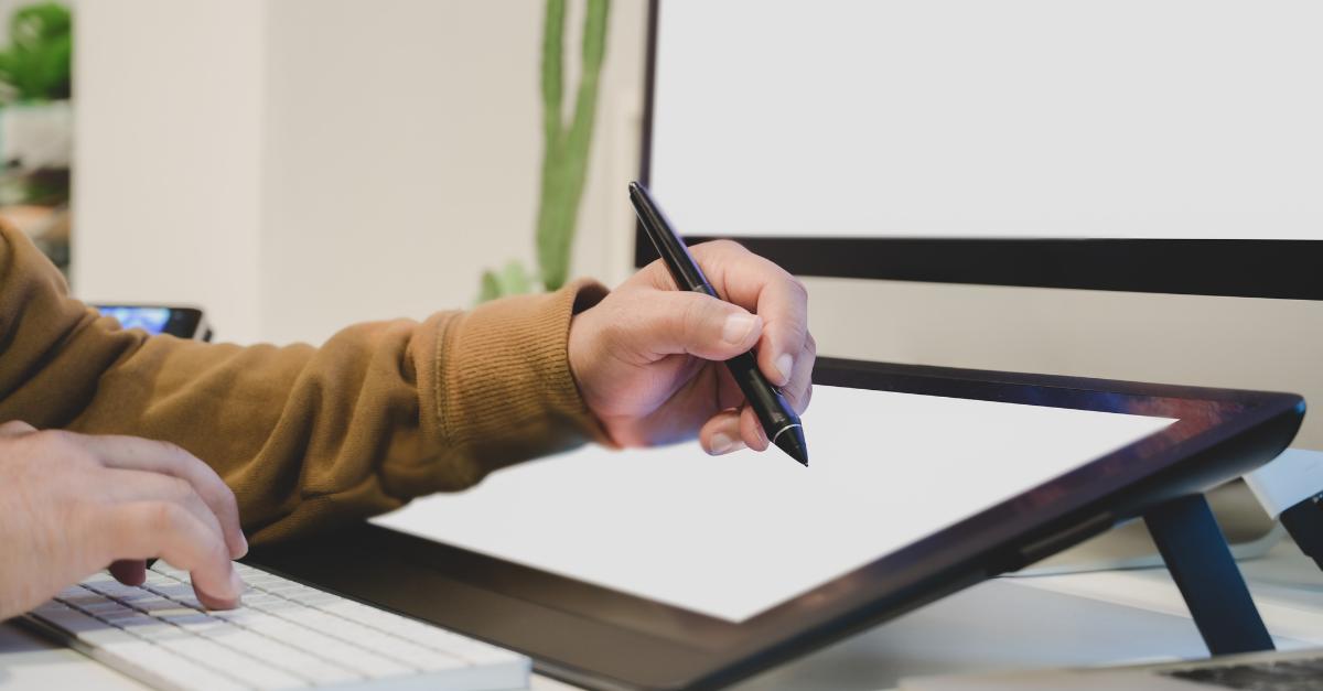graphic designer using a tablet to design a logo