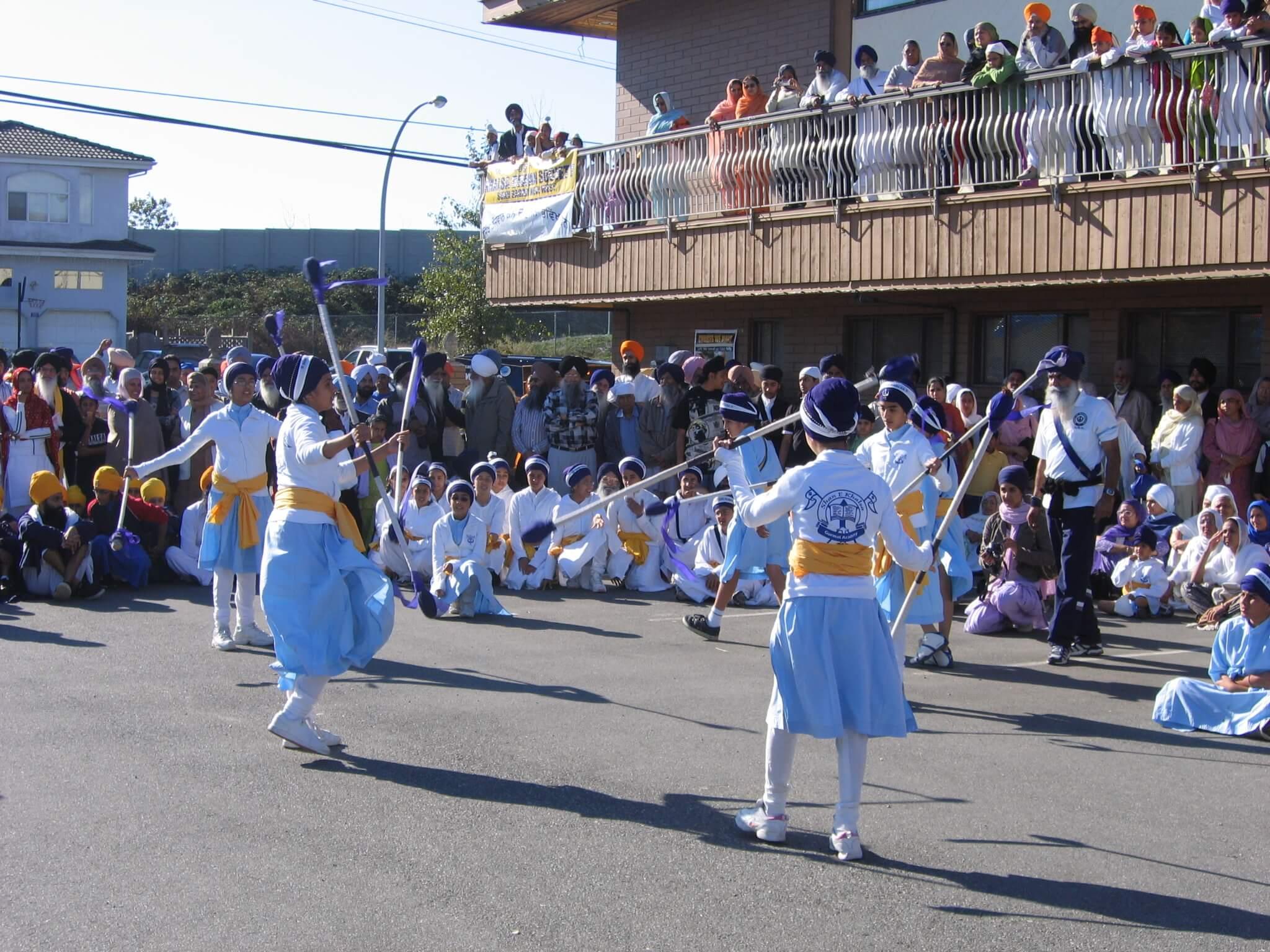 Sikh students performing gatka (sikh martial arts)