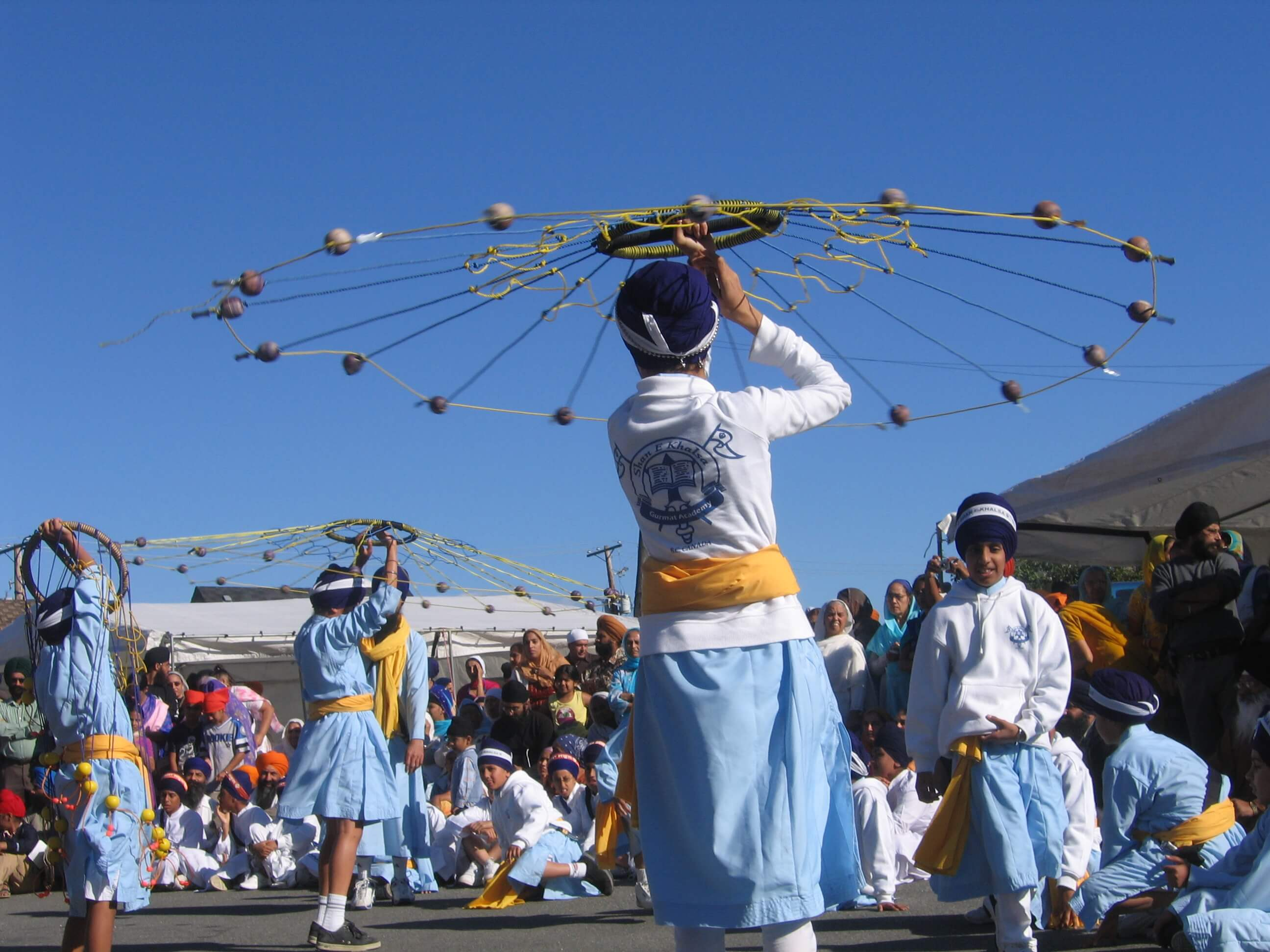 Sikh students performing sikh martial arts at a sikh event