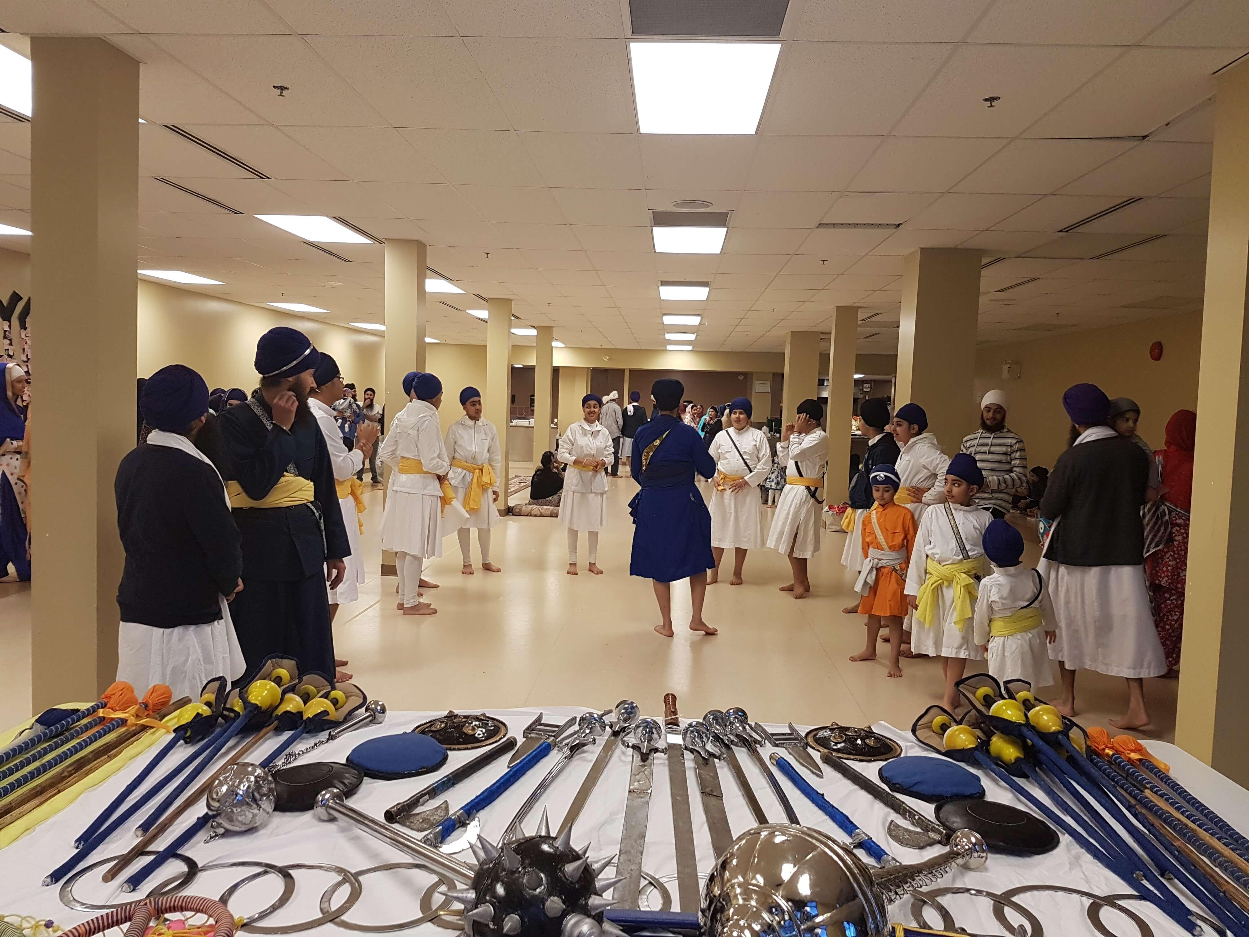 Sikhs performing playing gatka (sikh martial arts)