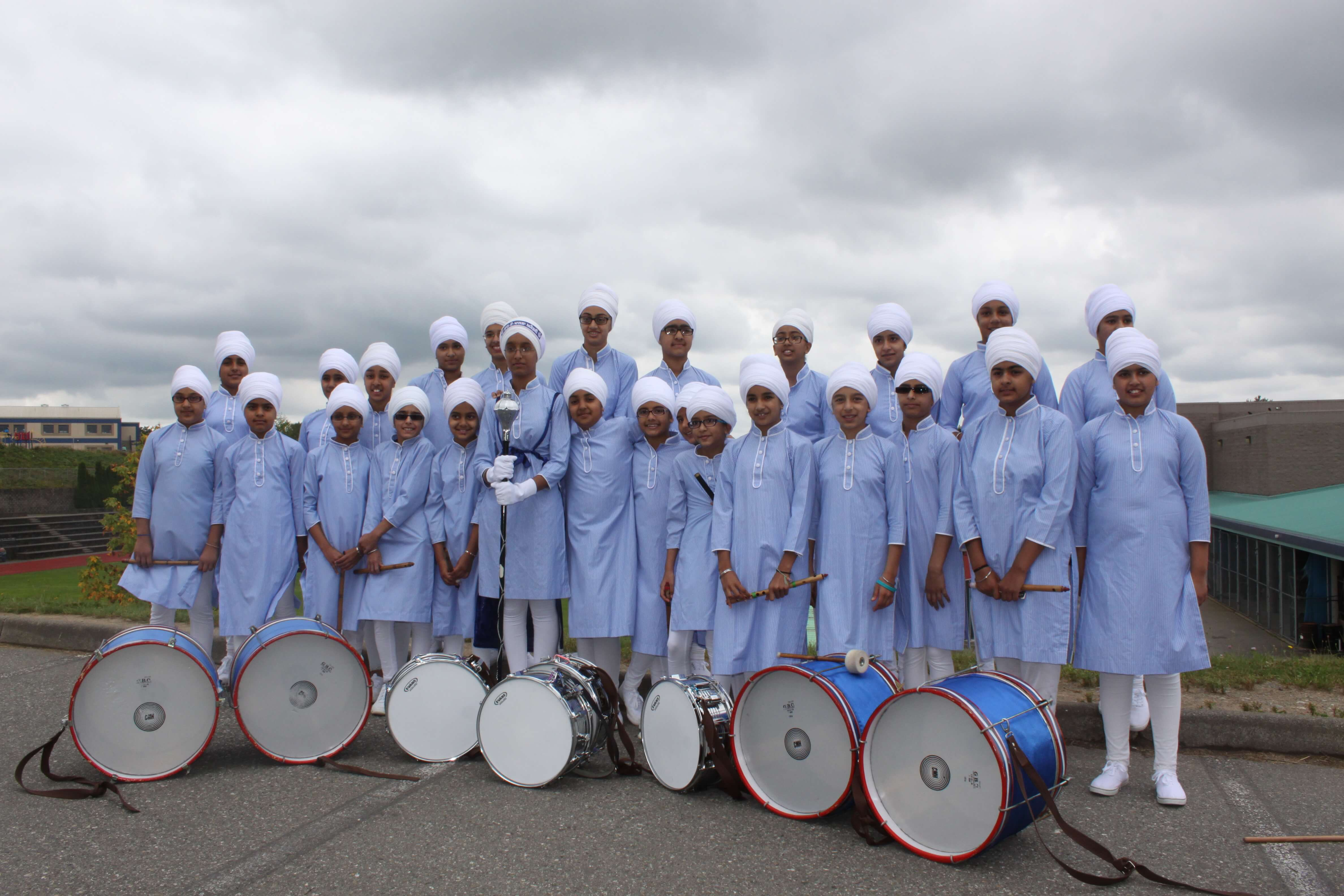 A band team posing for a picture with their instruments