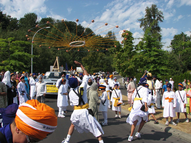 Sikh students performing sikh martial arts at a sikh parade