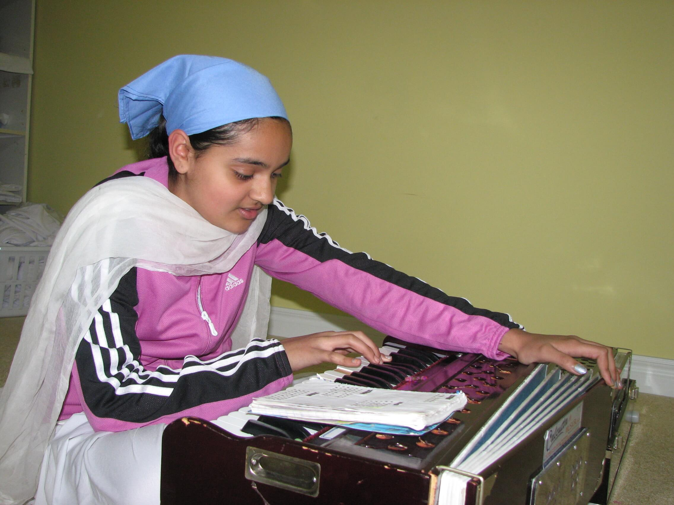 A student playing the harmonium