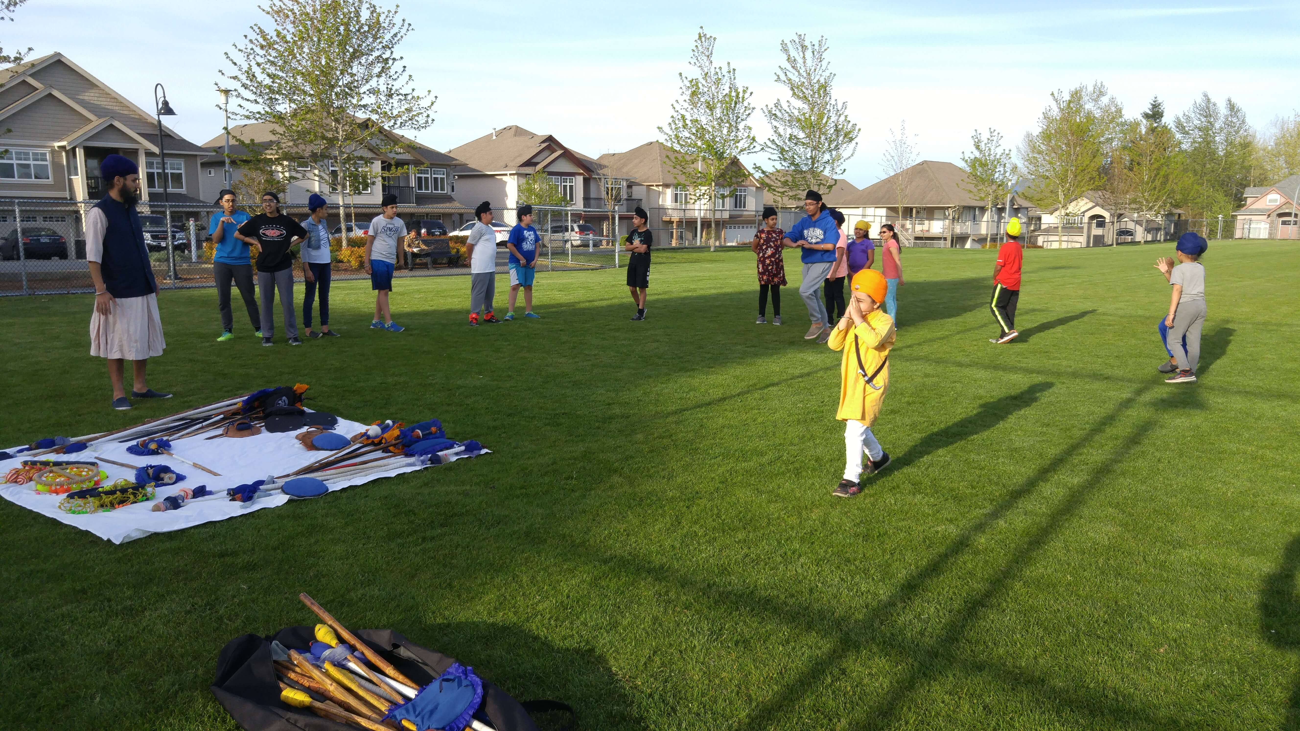 A group of students practicing sikh martial arts