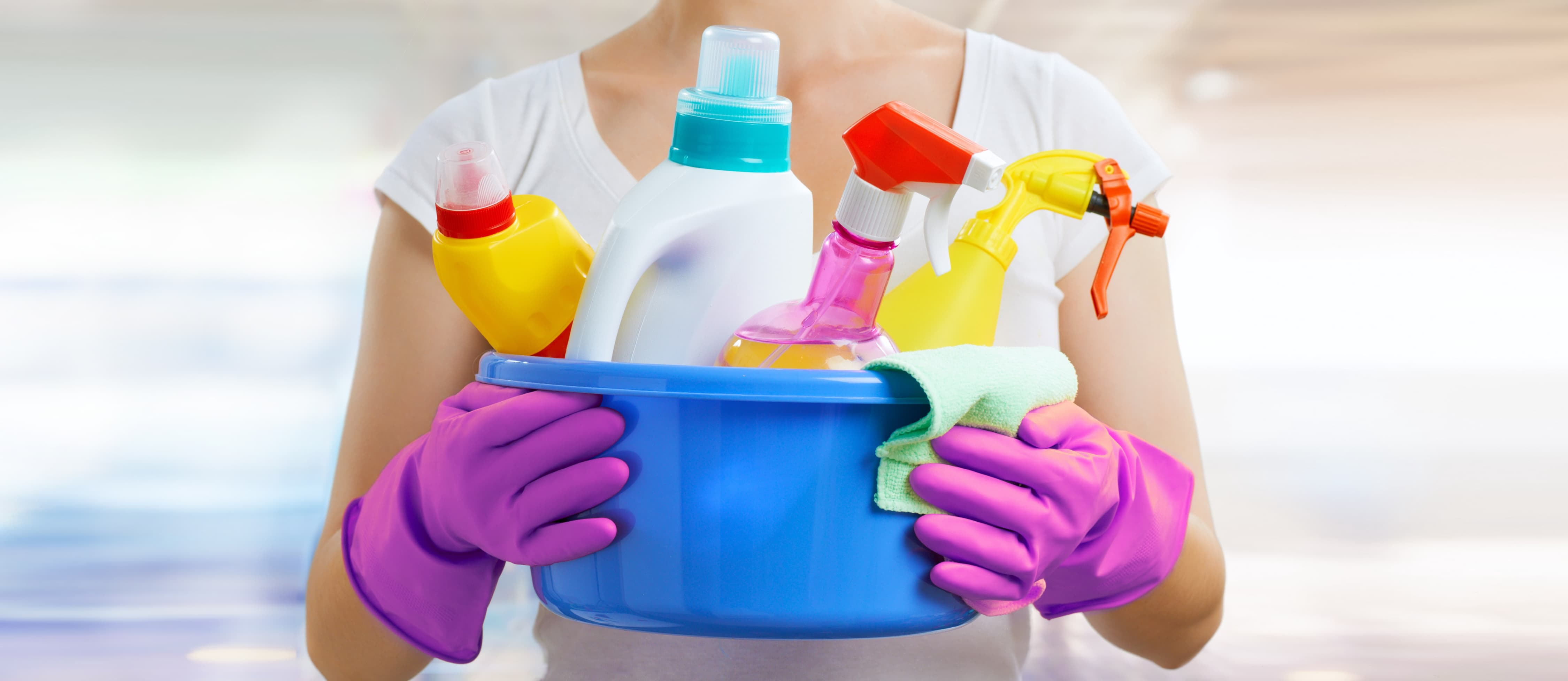 A Gleem Staff member holding cleaning supplies.