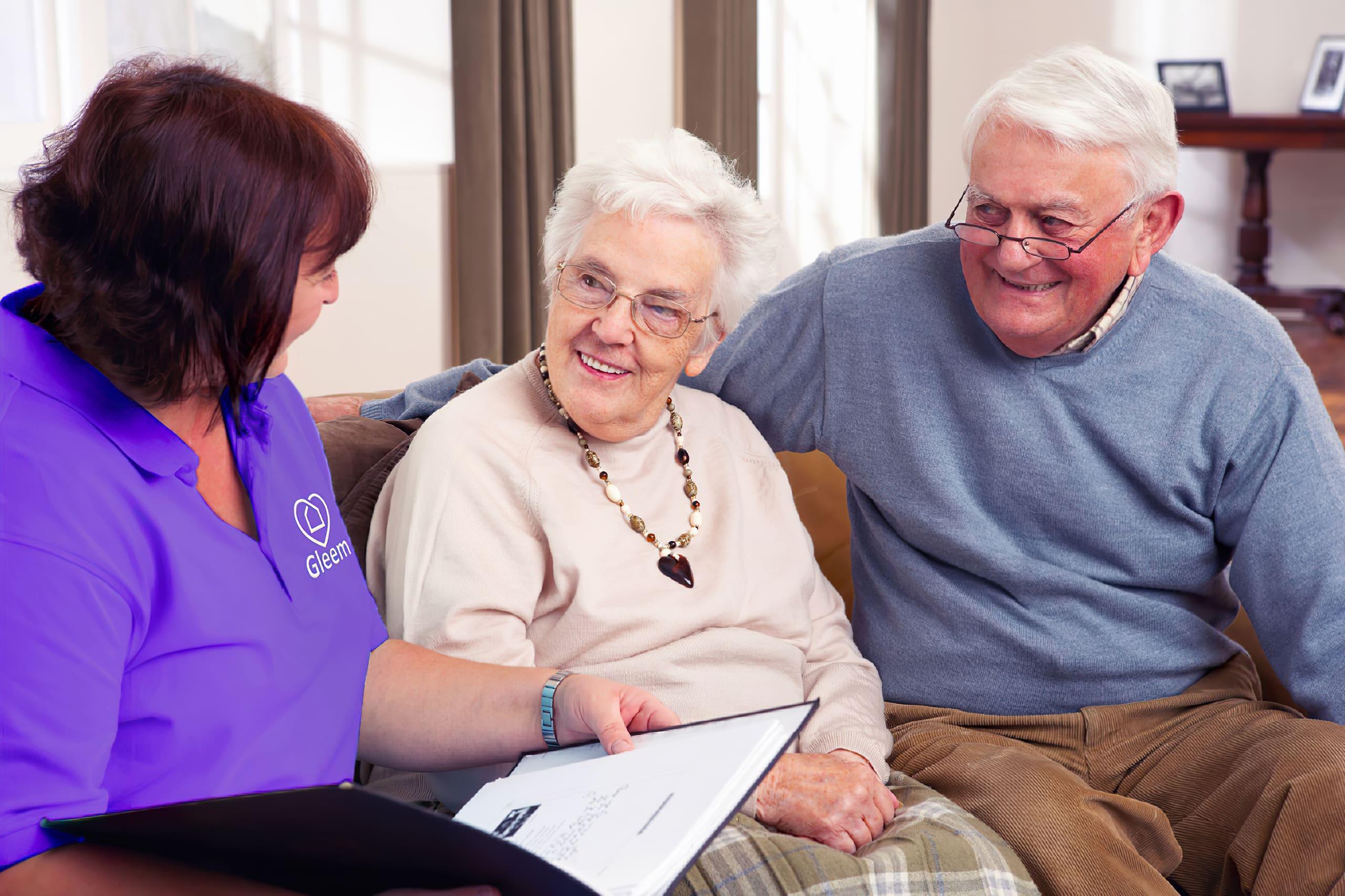 Gleem plus helper with two elderly persons.