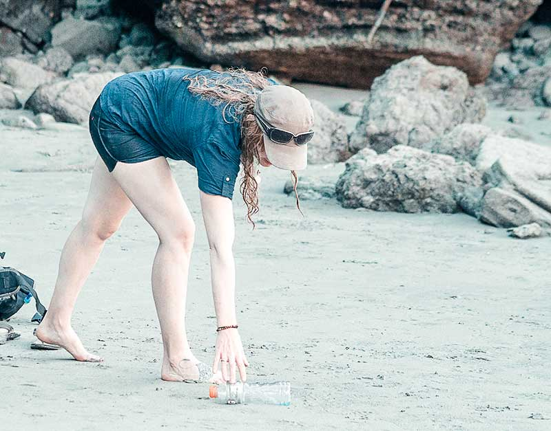 Natalie cleaning up the beach.