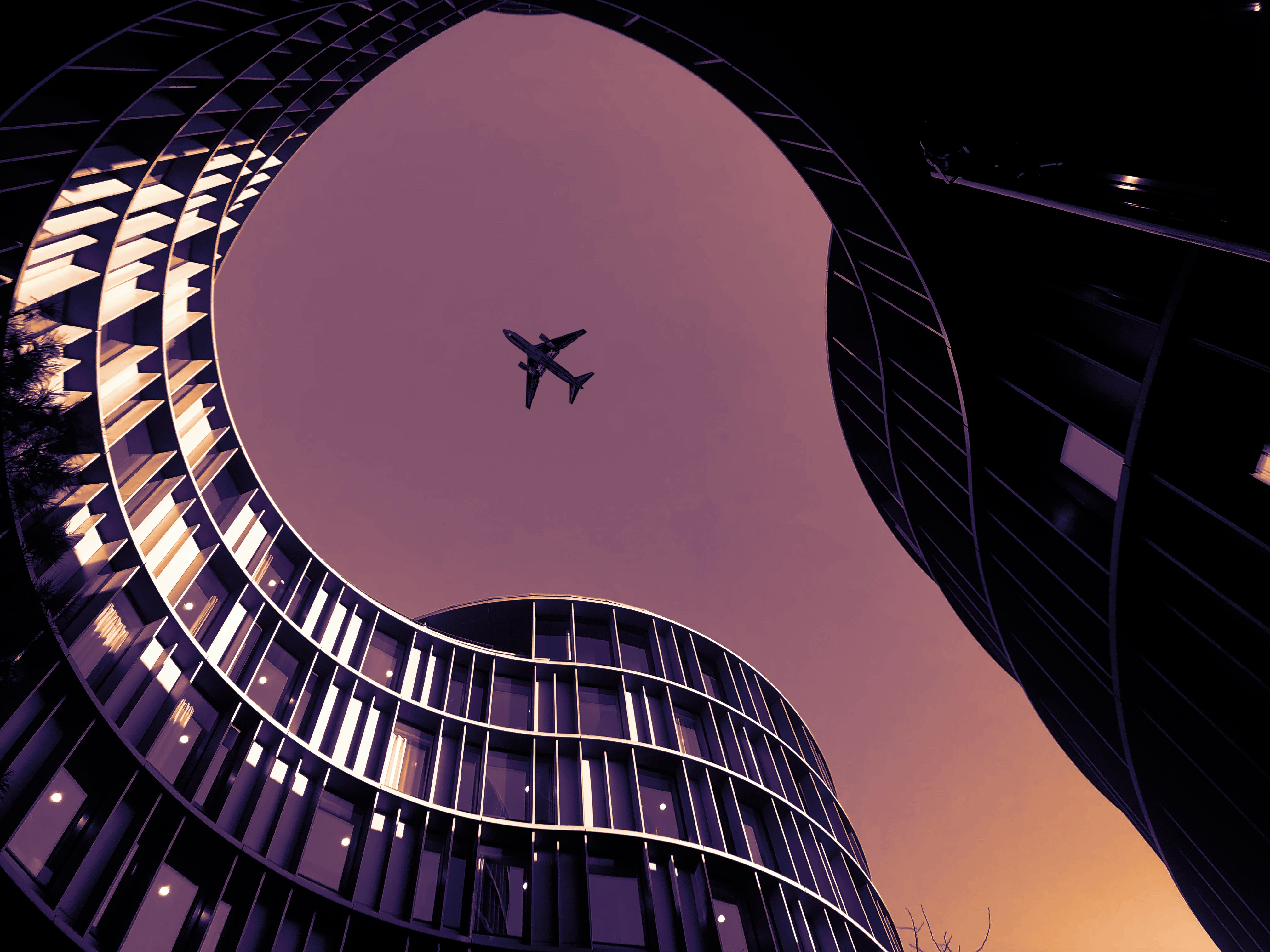 Airplane over buildings