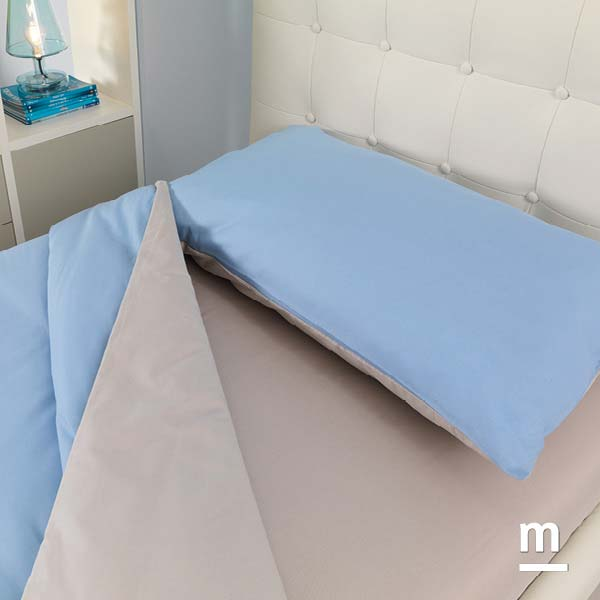 Biancheria del letto in cotone bifacciale azzurro e grigio