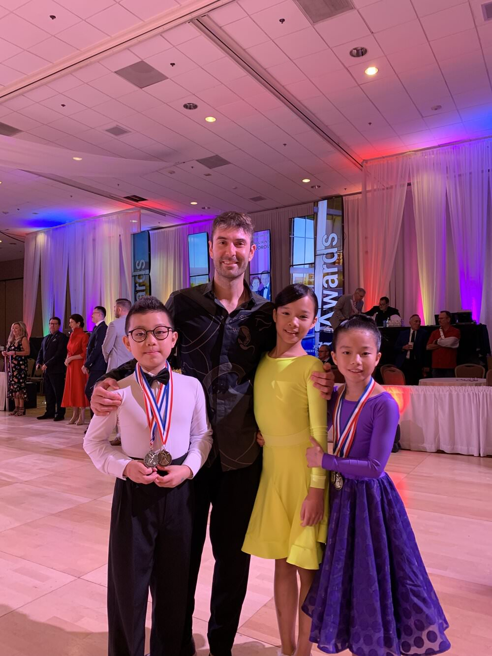 a picture of Atanas with little dancers at Desert Classic Dancesport Championships