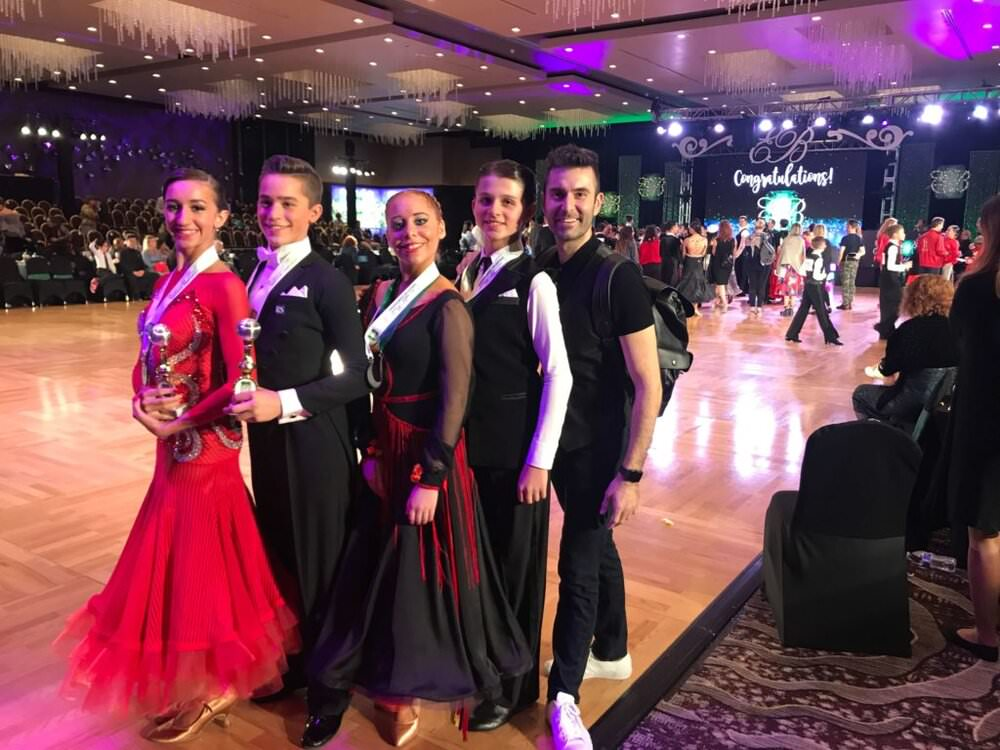 a picture of couples coached by Atanas at Emerald Ball